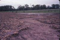 Muddy eroded field, 1985