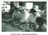 Cooks preparing meal, Shinkyo commune, Nara-ken, Japan, 1965