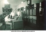 WSUI employees examining station equipment, The University of Iowa, 1940s