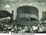 Group of people on stage at Macbride Hall for Founder's Day, The University of Iowa, 1940s