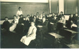 Children at desks in classroom, Iowa, 1910s