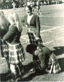 University of Iowa Scottish Highlanders dancers on sidelines of football game, 1969 or 1970