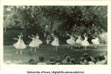 Dancers in tutus performing on lawn, The University of Iowa, June 5, 1922