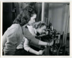 One cadette is using an optical telescope system in the Aeronautical Laboratory, 1943
