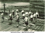 Marjory Camp students doing a canoeing land drill, The University of Iowa, 1930s