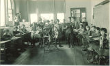 Classroom spinning and weaving demonstration, The University of Iowa elementary school, 1920s