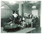 Students in a lounge in Hillcrest, the University of Iowa, 1950