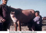 Chinese men with horses, China, 1944