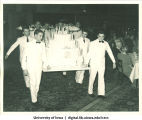 Waiters carrying cake at Centennial Dinner, Iowa Memorial Union, University of Iowa, February 25, 1947