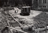 View of early construction on the 1st library addition, 1960