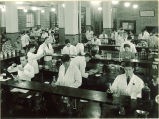 Students at workstations in pharmacy laboratory, The University of Iowa, October 19, 1937