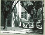 Walking past Burge Residence Hall, the University of Iowa, 1960s?