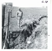 Eldon Wohlers inspecting gully on his farm