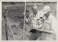 Ray Wycoff and George Carlson assessing soil conditions.