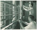 Engineering students working with metal tubing in engineering laboratory, The University of Iowa, 1939