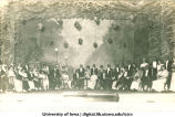 Actors on stage with hanging lanterns, The University of Iowa, ca. 1920