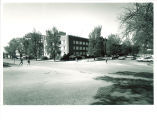 Main Library construction viewed from the corner of Iowa Avenue and Madison Street, the University of Iowa, April 1970