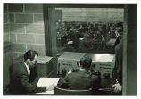 Control booth of WSUI with University Chamber Orchestra performing in studio, The University of Iowa, 1940s