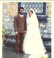 Ainsley Bernard standing with his bride
