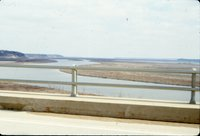 Road bridge overlooking water, 1980