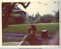 John, Jr. sitting in golf cart