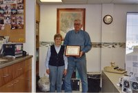 2001 -Holly and Kay Wagner hold award as Cooperator of the Year winners.
