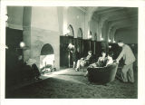 Lounging near a fireplace in the Iowa Memorial Union, the University of Iowa, July 1929