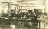 Students studying in the Main Library in Macbride Hall, the University of Iowa, 1910s