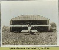 Rear view of plane entering hangar<br />