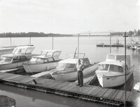 Man stands on dock by boats