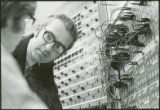 Two researchers work on a control panel, 1970