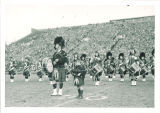 Scottish Highlanders performing at football game, The University of Iowa, October 26, 1948