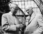 Dr. I.E. Melhus and Dr. L.W. Durrell examining a plant, 1956