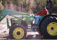 2002 - Terrance Rudolph, Des Moines County Soil and Water Conservation District Conservationist, drives a  John Deere tractor.