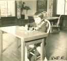 Girl playing at table, The University of Iowa, January 12, 1938