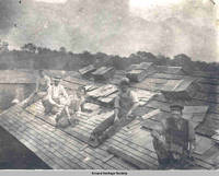 Carpenters shingling roof, Amana Colonies, Iowa, ca. 1920s
