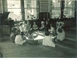 Children in circle listening to music, The University of Iowa, 1920s