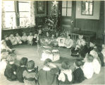Children gathered around Christmas tree, The University of Iowa, 1920s