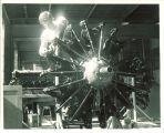 Engineering student working on airplane engine, The University of Iowa, 1950s
