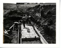 Construction of water control structure on Sonksen farmland.