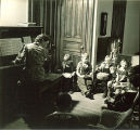 Children gathered around piano, The University of Iowa, February 22, 1938