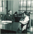 Professor and student in pharmacy office,The University of Iowa, 1940s