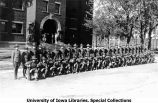 Cadets posing with rifles at south entrance of Old Armory, The University of Iowa, 1929