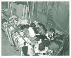 Cleaning up wardrobe after flooding of Theatre Building, The University of Iowa, June 1962