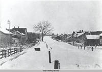 "Street scene of ""back street"" in winter, Amana, Iowa, 1900s"