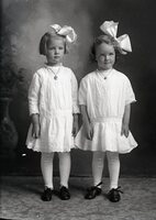 Two girls with bows