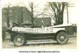 Touring car in Mecca Day parade, The University of Iowa, 1920