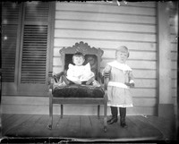 UP466 Two children on porch