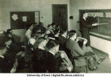 Instructor demonstrates a slide ruler to students, The University of Iowa, 1920s