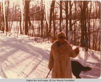 Elizabeth walking Sadie in winter